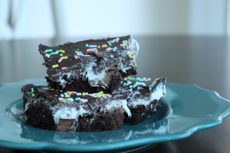 These Cadbury Mini Egg Brownies with marshmallow frosting are the perfect Easter treat! They're ooey, gooey, soft and chewy... no better dessert! #dessert #brownies #easter #marshmallows #frosting