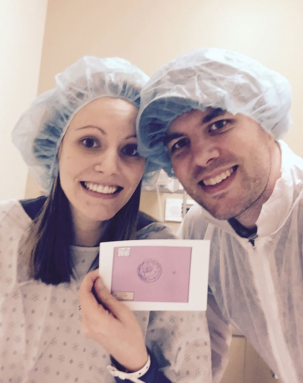 Couple holding frozen embryo photo before Frozen Embryo Transfer (FET).